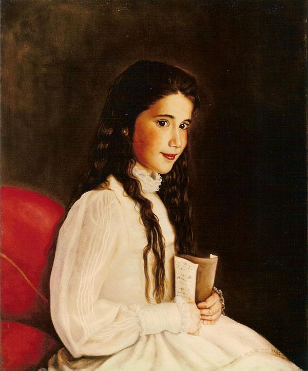 Natalia con traje de primera comunión y partitura